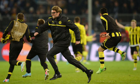 Dortmund coach Jurgen Klopp celebrates with his players after their dramatic Champions League win