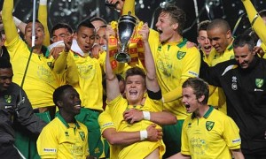 Norwich's Cameron McGeehan lifts the FA Youth Cup as his teammates celebrate the triumph